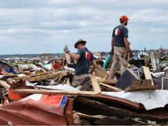 Members of Team Rubicon work in Joplin, Mo., after its deadly tornado in May.