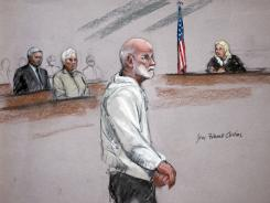 "In this courtroom sketch, James ""Whitey"" Bulger stands during his initial appearance in a federal courtroom in Boston on Friday."