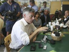 GOP presidential candidate and former Utah governor Jon Huntsman talks to education and business leaders Thursday at Sarussi Cafe in Miami.