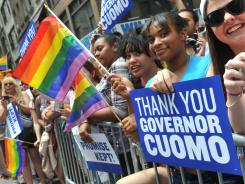 People recognize Gov. Andrew Cuomo for signing the law at the annual Heritage of Pride March on Sunday in New York City.