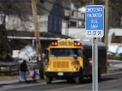 A sign along Route 9 in Ossining, N.Y., marks the spot for an emergency bus stop that is part of the Indian Point nuclear plant evacuation plan.