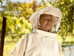 Not in her backyard? Beekeeper Nicole Perullo of Corte Madera, Calif., is embroiled in a legal debate that's popping up all over the USA.