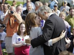 Michele Bachmann hugs husband Marcus after she announced her entry into the GOP presidential field in Waterloo, Iowa.