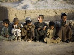 Displaced Afghan boys from Helmand province read the Quran in an improvised mosque at Afshar refugee camp in Kabul, Afghanistan.