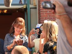 "Sarah Palin greets supporters in Pella on Tuesday before attending a screening of ""The Undefeated,"" a film about her work in Alaska and rise in national politics."