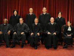 From left on front row, Justices Clarence Thomas, Antonin Scalia, Chief Justice John Roberts, Anthony Kennedy and Ruth Bader Ginsburg. From left, back row, Justices Sonia Sotomayor, Stephen Breyer, Samuel Alito and Elena Kagan.