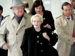 Former Illinois governor George Ryan leaves the federal courthouse with his wife Lura Lynn Jan. 21, 2005 in Chicago. Lura Lynn passed away Monday at age 76.