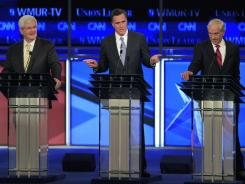 Former governor  Mitt Romney, center, former House speaker Newt Gingrich, left, and Rep. Ron Paul, right, face off at the 2012 presidential forum in Manchester, N.H.