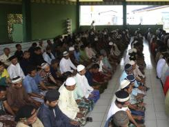 Prisoners pray at a mosque inside Porong prison, East Java, Indonesia.