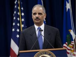 Attorney General Eric Holder speaks at the Justice Department.