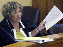 Kansas state Sen. Vicki Schmidt, a Topeka Republican, asks questions of the Kansas Department of Health and Environment about new regulations for abortion clinics Thursday.