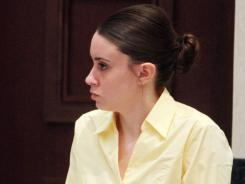Casey Anthony stands before the start of court on Friday in Orlando.