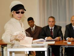 A Moroccan woman casts her vote in a polling station in Rabat, Morocco, Friday.