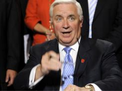 Pennsylvania Gov. Tom Corbett reacts after signing the state budget documents in the rotunda of the capitol Thursday in Harrisburg, Pa.