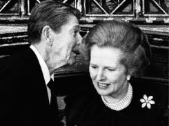 President Ronald Reagan has a word in the ear of Britain's Prime Minister Margaret Thatcher at a 1984 reception.