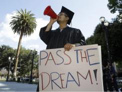Ruben Bernal, a recent San Jose State University graduate, rallies for the DREAM Act in downtown San Jose, on Wednesday.