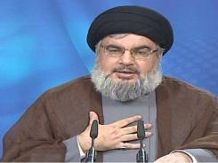 Hezbollah leader Sheik Hassan Nasrallah speaks during a broadcast during which he defended the men indicted in the murder of a former prime minister of Lebanon.