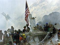An American flag flies over the rubble of the World Trade Center in New York shortly after 9/11.
