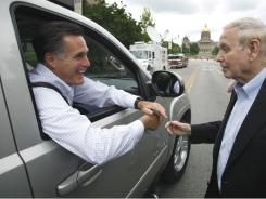 Former Massachusetts Gov. Mitt Romney talks with former Iowa Gov. Bob Ray after speaking at the Mediacom 2012 Presidential Candidate Series in Des Moines, Iowa.