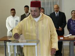 Morocco's King Mohammed VI casts his vote in a polling station in Rabat, Morocco, Friday Jul 1, 2011. The King voted in the referendum on the new constitution.