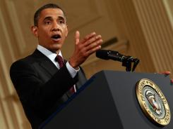 Stern warning: Obama talkes about the debt limit debate at a news conference last week.