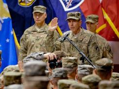 Gen. David  Petraeus administers the re-enlistment oath to 235 U.S. servicemembers during a ceremony Monday.