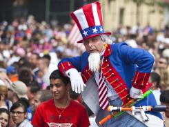 A man dressed as Uncle Sam entertains the crowd during the 2011 Nathan's Famous Fourth of July International Hot Dog Eating Contest in Coney Island.