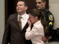 Acquitted:  Defense attorney Jose Baez and Casey Anthony react as the verdict is read.