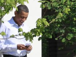 President Obama uses his BlackBerry to communicate with supporters.