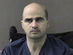 Fort Hood's commanding general announced Wednesday that  Maj. Nidal Hasan, pictured, charged in the deadly Fort Hood rampage in Texas, will be court-martialed and face the death penalty.