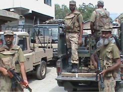 In this low resolution image, troops of the Pakistan army get ready to go in the troubled area in Shahi Kot, Pakistan, Wednesday.
