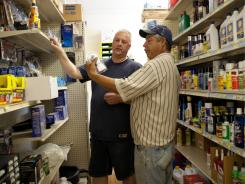 Sergio Rodriguez, right, talks to Scott Weston, owner of Master Supply & Hardware in Kent City, Mich., about a home improvement project he's working on.