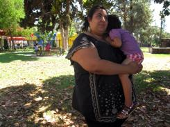 Maricela Mares-Alatorre poses for a photograph while visiting a local park in Freno, Calif.