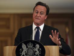 Britain's Prime Minister David Cameron speaks during a press conference  Friday at 10 Downing Street, London.
