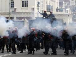 Malaysian riot police officers fire tear gas at protesters during a rally calling for electoral reforms in Kuala Lumpur, Malaysia, on Saturday.