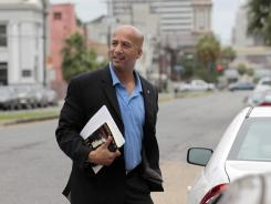 Former mayor Ray Nagin arrives to talk about his new book, 'Katrina's Secrets,' at a news conference in New Orleans.