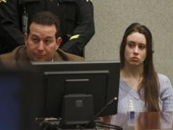 Casey Anthony and her attorney, Jose Baez, listen to arguments during her sentencing hearing Thursday.