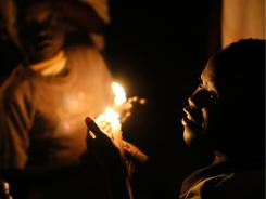 South Sudanese boys hold candles as the clock ticks over to midnight Saturday to mark the day that South Sudan will officially declare independence.