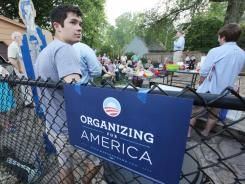 Iowa Treasurer Michael Fitzgerald, background, leads an organizing meeting for the Obama re-election campaign in the backyard of Sam Reno's Des Moines, Iowa, home on Thursday.