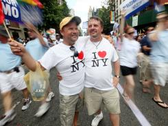 Joe Bednar, right, and Phil Mason march in New York City's pride parade June 26, two days after state lawmakers legalized same-sex marriage.