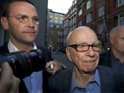 Rupert Murdoch, right, and son James Murdoch, chief executive of News Corp. Europe and Asia arrive in central London, Sunday.