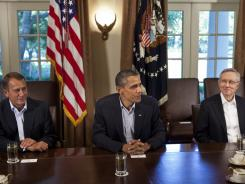 President Obama meets with House Speaker John Boehner and Senate Majority Leader Harry Reid to negotiate the national debt.