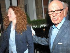 Rebekah Brooks and Rupert Murdoch are seen outside Murdoch's central London residence Sunday.