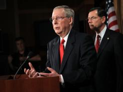 Senate Minority Leader Mitch McConnell, R-Ky., with Sen. John Barrasso, R-Wyo., proposed a formula that would allow President Obama to raise the debt limit without a deal.