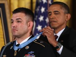 President Obama presents the Medal of Honor to Army Sgt. 1st Class Leroy Petry. Petry is the second living recipient from the wars in Iraq and Afghanistan.
