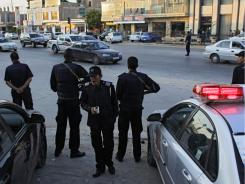 Libyan special emergency police officers are seen at the crossroads as they partol in rebel-held Benghazi on Tuesday.