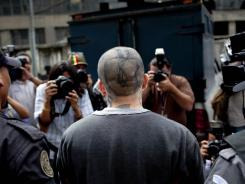 "Gang member of the criminal organization Mara 18, Axel Danilo Perez Espinoza, alias ""Smiley,"" is escorted to his sentencing hearing in Guatemala City on Tuesday."