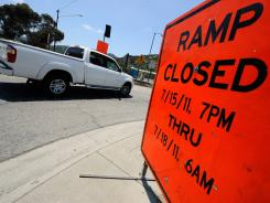 A sign advises motorists of a freeway ramp closure during the shutdown of Interstate 405 for 53 hours starting Saturday.