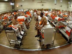 "Fish bowl: Inmates sit in crowded conditions at the California Institute for Men in Chino. The Supreme Court ruled that the state's prison system is ""incompatible with the concept of human dignity."""