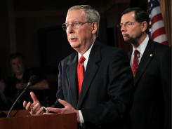 Senate Minority Leader Sen. Mitch McConnell, R-Ky., with Sen. John Barrasso, R-Wyo., proposed a formula that would allow President Obama to raise the debt limit without a deal.